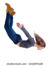 Side view of woman in zero gravity or a fall. girl is flying, falling or floating in the air.  side view of person. Isolated over white background. The girl in jeans falls down in a free fall.