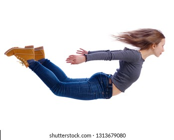 Side view of woman in zero gravity or a fall. girl is flying, falling or floating in the air. Side view people collection.  Isolated over white background. A young girl in jeans and boots is flying in
