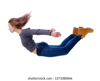 Side view of woman in zero gravity or a fall. girl is flying, falling or floating in the air.  side view of person. Isolated over white background. Girl flies down jumping from a helicopter.