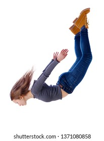 Side view of woman in zero gravity or a fall. girl is flying, falling or floating in the air.  Isolated over white background. The girl in jeans falls down in a free fall.