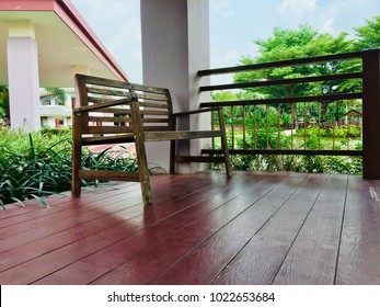 Side view Wooden chair in the pavilion of the garden.