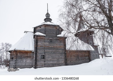 Side view of a wooden church in the snow