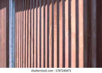 side view of wooden fence with sunlight