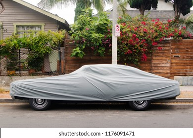 A side view of a wrapped up covered car in Venice, California