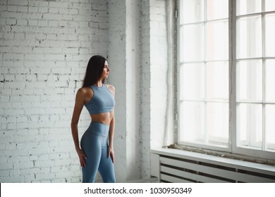 Side view of young active sports running woman athlete. with copy concept space sport health fitness weight loss cardio workout jog workout wellness.