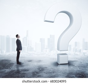 Side view of young adult businessman looking at question marks on abstract foggy gray background. Research concept. 3D Rendering