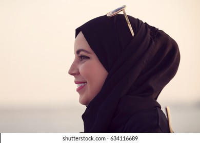side view of young Arab woman outdoors