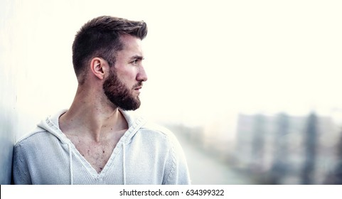 Side view of young bearded man isolated on white background