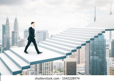 Side view of young businessman climbing abstract stairs on bright Kuala Lumpur city background. Career development and growth concept