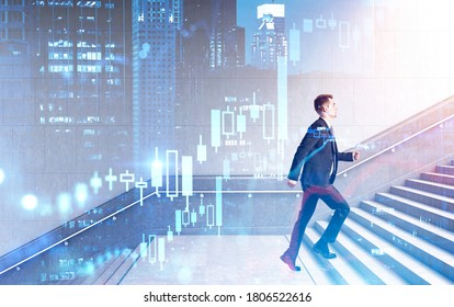 Side view of young businessman climbing stairs in city with double exposure of financial graphs. Toned image
