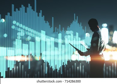 Side view of young businessman holding document on abstract night city background with abstract digital business chart hologram. Trade concept. Double exposure