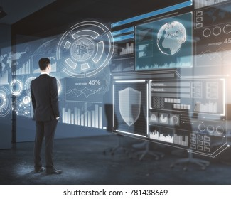 Side view of young businessman looking at creative digital business interface in blurry office. Infograph and touchscreen concept. Double exposure