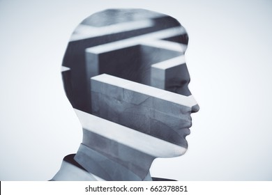 Side view of young businessman and maze on light background. Challenege concept. Double exposure