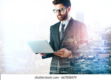 Side view of young businessman using laptop on abstract city background with copy space. Communication concept. Double exposure