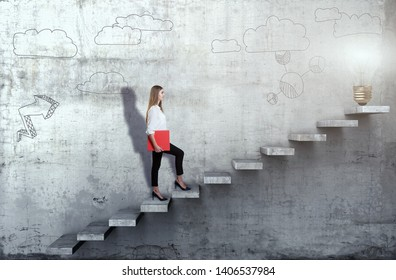 Side view of young businesswoman climbing the stairs with idea lamp on concrete background