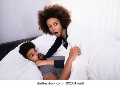 Side View Of A Young Couple Get Caught While Cheating In Bed