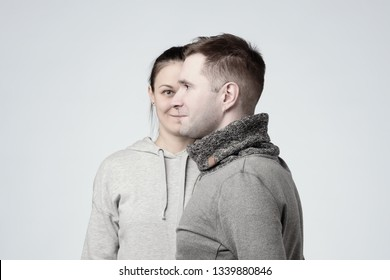 Side view of young european couple man and woman as one face. The concept of strong family relationships. Husband and wife trust in each other.