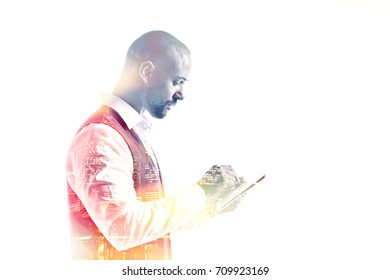 Side view of young office worker holding a tablet pc double exposure
