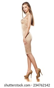 SIde view of young pretty woman in tight short dress posing on white background