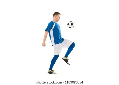 side view of young soccer player training with ball isolated on white