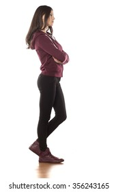 side view of a young woman in a track suit and pants