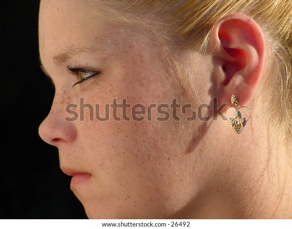 Side view of a young woman's face.