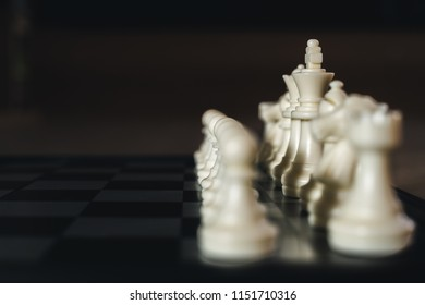 Side of white chess on chess board game, soft to focus, ideas for business, leadership, teamwork and plan concept.