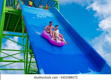 Side,Antalya/Turkey-06.12.2019-Maximum fun for peoples on the Kamikaze slide in the Aquapark of Crystal Admiral Resort and Spa. When you try it for the first time, you are breathless