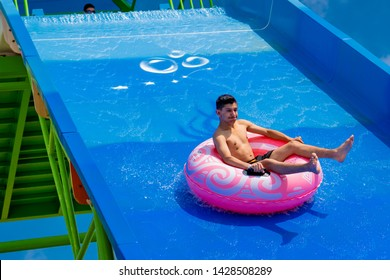 Side,Antalya/Turkey-06.12.2019-Tourists at the hotel's aqua park in Turkey remain breathless as they slide in the biggest slide named kamikaze.The level of adrenaline increases instantly