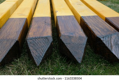 Side-by-side sharpened wooden pillars