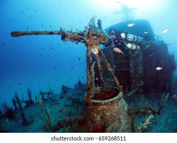 Sidemount diver diving the P-29 Minesweeper Wreck - Cirkewwa - Malta