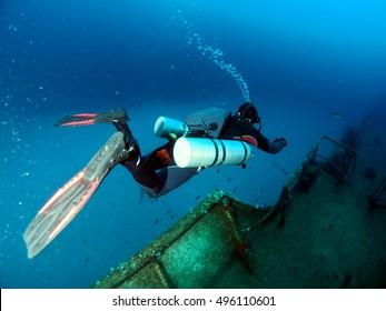 Sidemount Diver exploring the Um el Faroud Wreck, Wied iz-Zurrieq, l/o Qrendi, Malta