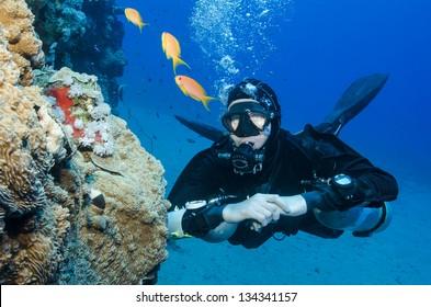 sidemount scuber diver in clear blue ocean