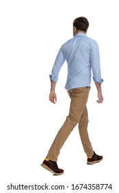 Side-rear view of casual man walking on white studio background