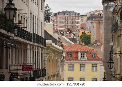 A sidestreet with colorful, historic houses in Lisbon, Portugal