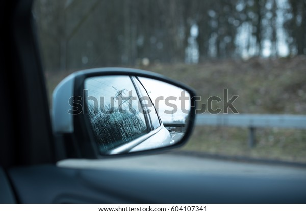 Side-view mirror of the car