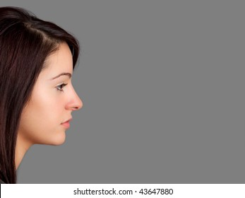 Side-view portrait of an attractive young woman. Room for text or copyspace.