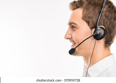 a side-view portrait of young smiling agent of call-centre