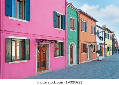 sidewalk by colorful houses in Burano, Italy