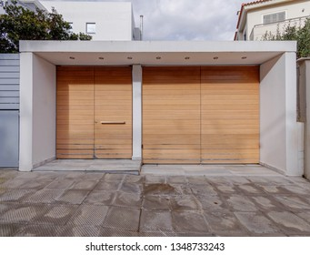 sidewalk by modern house entrance natural wooden wood pedestrian's and car's door, some space for text