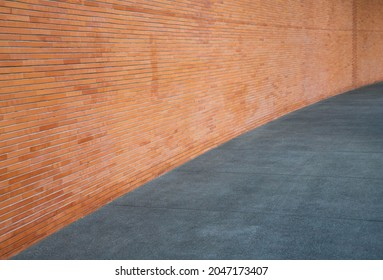 sidewalk by street wall, may be used as background or texture.