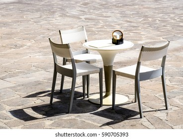sidewalk cafe - table and chairs
