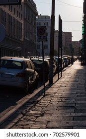 Sidewalk and Cars at Sunrise in Rome, Italy
