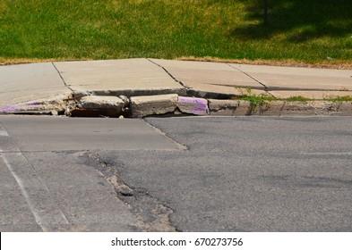 Sidewalk and curb damage.