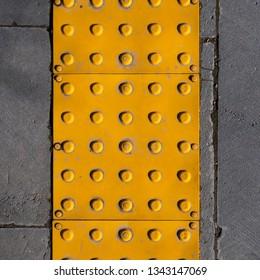 Sidewalk guide or tactile paving floor for blind people, close up