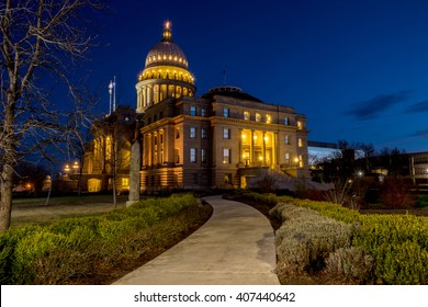 Sidewalk to the Idaho state capital building at night with blue sky and lights
