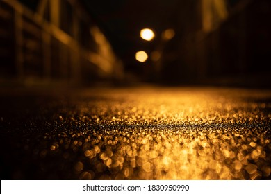 sidewalk and lights from street lights and blurred background at night under rain in the center of Prague - Shutterstock ID 1830950990