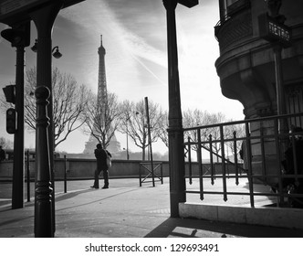 Sidewalk and metro entrance in Paris, France. Eiffel Tower in the background