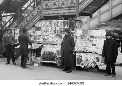 A sidewalk newsstand in New York City displaying a rich variety of periodicals published at the turn of the century. 1903.