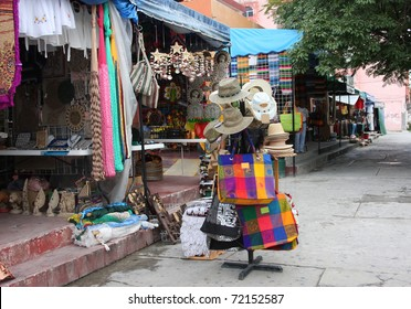 Sidewalk shopping in Mexico for vacation souvenirs.